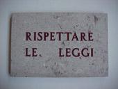 Salvo, Rispettare le leggi, 1972, incisione su lastra di pietra, 25 x 38 cm, 7/20, courtesy Galleria Martano, Torino